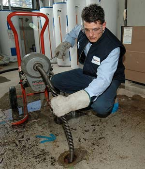 Mike is one of the top plumbers in Ashburn and he is working on unclogging a drain