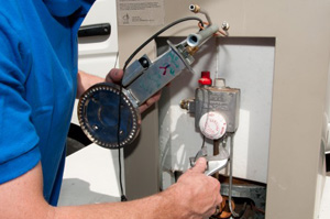 Mike, one of our Ashburn water heater repair pros is fixing a water heater unit